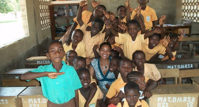 Brandi Neal poses with a group of Ghandaian students on her first trip to Ghana/Photo courtesy of Neal