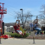 Students glide through the air on a zip line during USI's SpringFest festivities.
