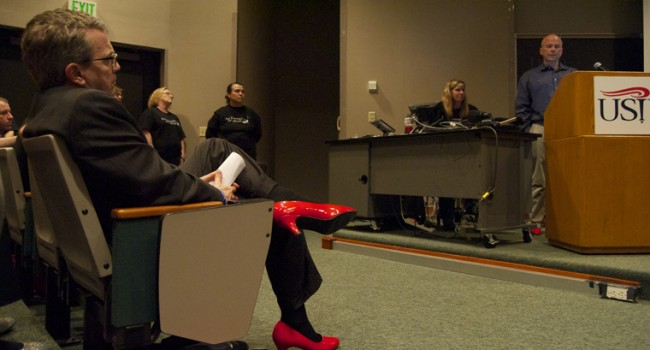 Mayor Lloyd Winnecke listens to Jerry Lewis speak at To Walk a Mile in Her Shoes Tuesday in Mitchell Auditorium.