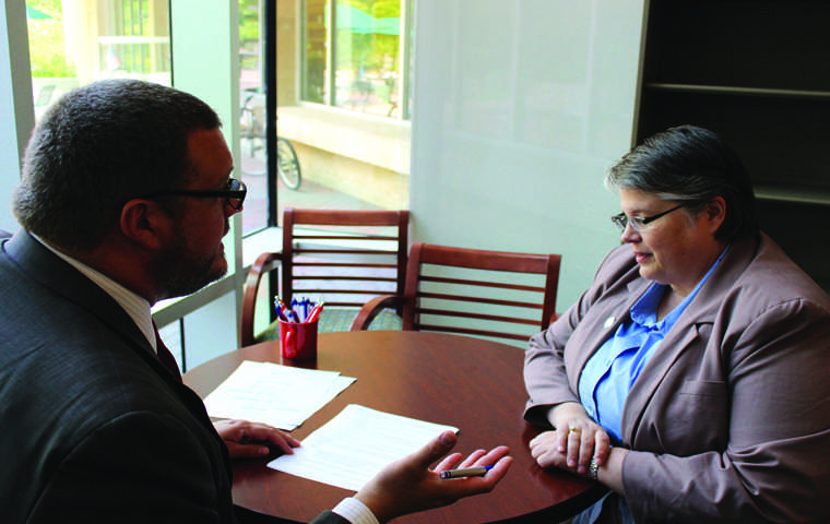 New Assistant Dean of Student Laurie Berry goes over paperwork with Dean of Students Bryan Rush Tuesday at DOSO/The Shield Isaac Williams
