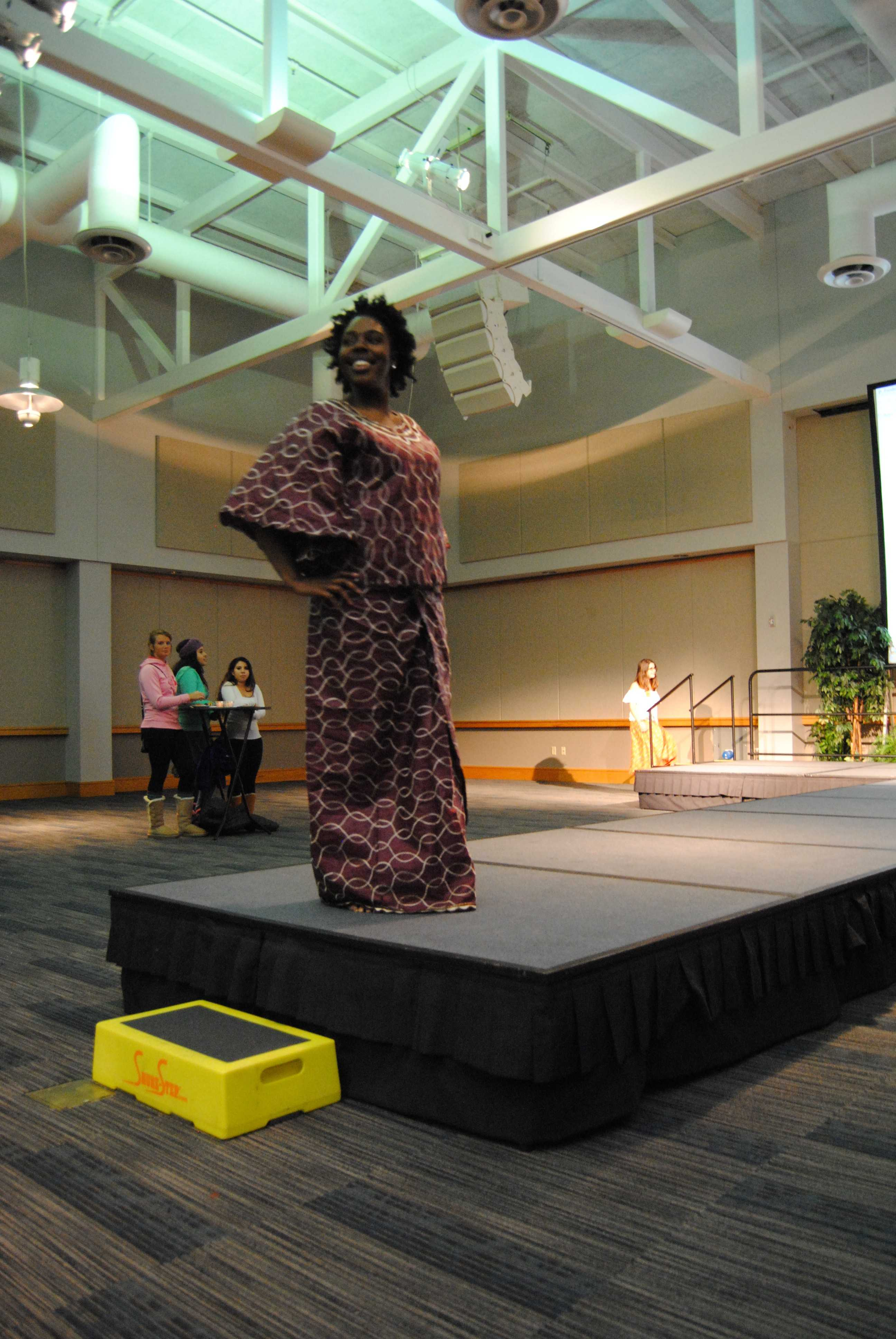 Senior psychology major Ariel Crenshaw poses in her hand-made dress from Ghana. Photo by Alyssa Smith/The Shield