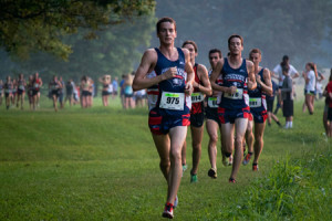 Johnnie Guy, a senior engineering major, leads the pack during the Stegemoller Classic in which the men's cross country team finished first at the beginning of the season. Their success this year led to coach Hillyard being named coach of the year