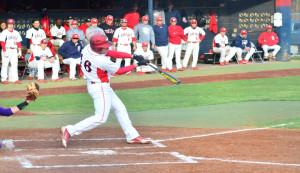 Kyle Kempf hits a ball during the 2013 spring season. File Photo/Jimmy Pyles