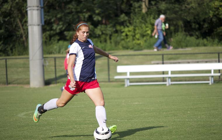 Sophomore defender, Sadie Schumann, advances the ball downfield.