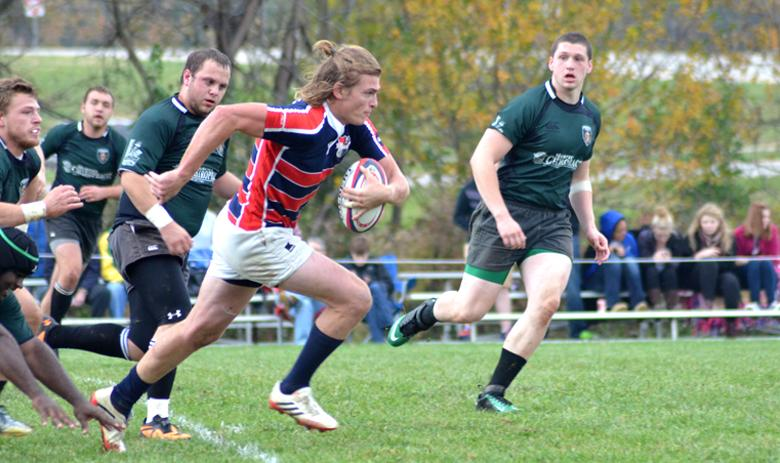 Flyhalf Doug Rose breaks aways from the University of Wisconsin players during the Regional Qualifier match.