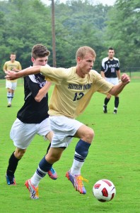 """Sophomore defender Josh Weinzapfel dribbles the ball down the field  during the """"Gold Game."""" Photo by JIMMY PYLES/The Shied"""
