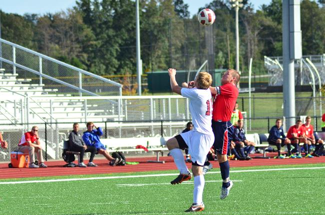 Corey Fundenberger jumps to head the ball. Fundenberger had two assists in USI's win over Saint Joseph's College.