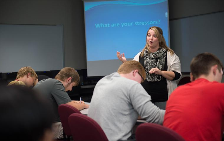 Student Support Services Program Director Heather Bauer teaches university student about stressors during a UNIV 101 course. Photography courtesy of Photo Services